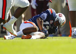 Auburn defensive back Jamel Dean (12) recovers a fumble against Texas A&M during the first half of an NCAA college football game, Saturday, Nov. 3, 2018, in Auburn, Ala. (AP Photo/Todd Kirkland)