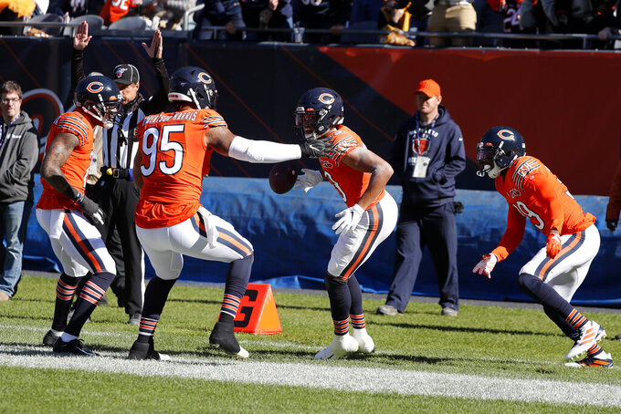 Chicago Bears cornerback Kyle Fuller, center, celebrates with teammates after intercepting a pass during the first half of an NFL football game against the Los Angeles Chargers, Sunday, Oct. 27, 2019, in Chicago. (AP Photo/Charles Rex Arbogast)