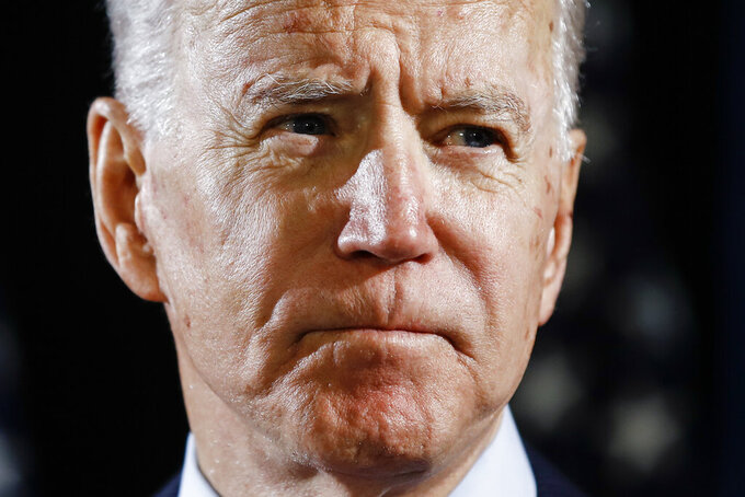 FILE - In this March 12, 2020, file photo Democratic presidential candidate former Vice President Joe Biden speaks about the coronavirus in Wilmington, Del. Biden has won the last few delegates he needed to clinch the Democratic nomination for president. (AP Photo/Matt Rourke, File)