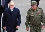 Russian President Vladimir Putin, left, and Russian Defense Minister Sergei Shoigu arrive to attend the joint strategic exercise of the armed forces of the Russian Federation and the Republic of Belarus Zapad-2021 at the Mulino training ground in the Nizhny Novgorod region, Russia, Monday, Sept. 13, 2021. The military drills attend by servicemen of military units and divisions of the Western Military District, representatives of the leadership headquarters and personnel of military contingents of the armed forces of Armenia, Belarus, India, Kazakhstan, Kyrgyzstan and Mongolia. (Sergei Savostyanov, Sputnik, Kremlin Pool Photo via AP)