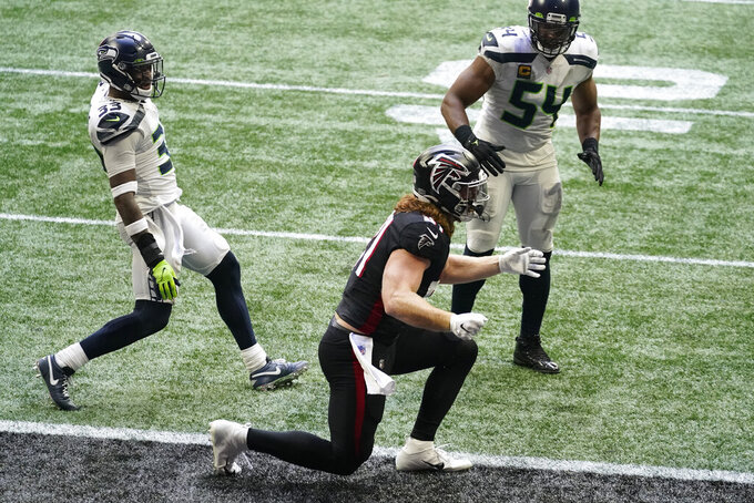 Atlanta Falcons tight end Hayden Hurst (81) reacts after a two-point conversion play against the Seattle Seahawks during the second half of an NFL football game, Sunday, Sept. 13, 2020, in Atlanta. (AP Photo/Brynn Anderson)