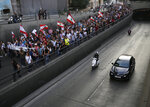 Anti-government protesters march during a protest against the central bank and the Lebanese government, in Beirut, Lebanon, Thursday, Oct. 31, 2019. Lebanese security forces were still struggling to open some roads Thursday as protesters continued their civil disobedience campaign in support of nationwide anti-government demonstrations. (AP Photo/Hussein Malla)