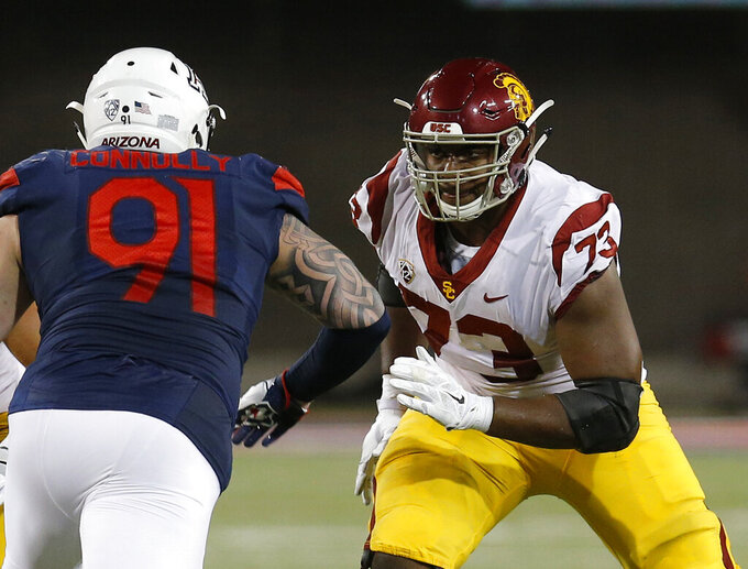 File- This Sept. 29, 2018, file photo shows Southern California offensive lineman Austin Jackson (73) in the first half during an NCAA college football game against Arizona in Tucson, Ariz. Jackson wants to lead Southern California back to the Pac-12 title, but the left tackle already scored a bigger victory when he donated bone marrow to his younger sister, Autumn, last month. (AP Photo/Rick Scuteri, File)