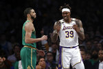 Los Angeles Lakers' Dwight Howard (39) celebrates after scoring next to Boston Celtics' Jayson Tatum during the first half of an NBA basketball game Sunday, Feb. 23, 2020, in Los Angeles. (AP Photo/Marcio Jose Sanchez)