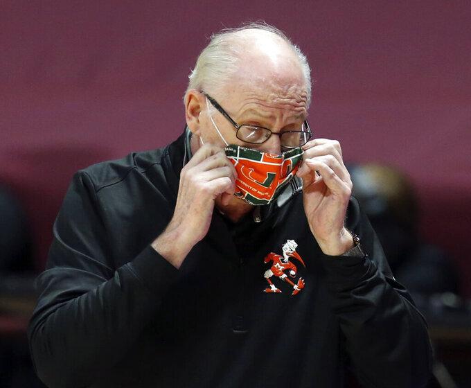 Miami head coach Jim Larranaga adjusts his mask during the first half of an NCAA college basketball game against Virginia Tech, Tuesday, Dec. 29, 2020 in Blacksburg, W.Va. (Matt Gentry/The Roanoke Times via AP, Pool)