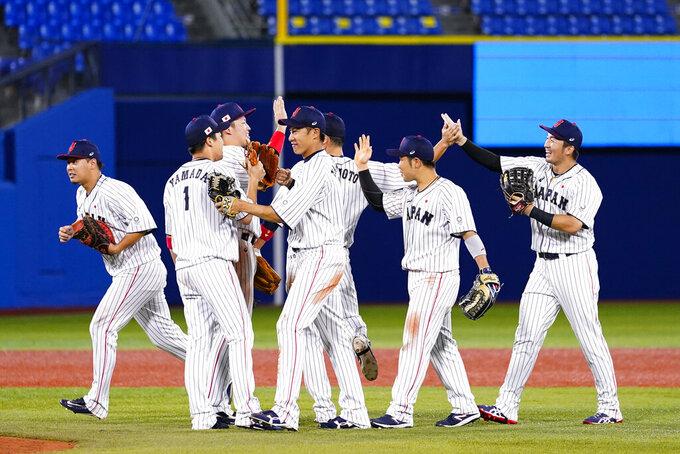 Members of team Japan celebrate after a semi-final baseball game against South Korea at the 2020 Summer Olympics, Wednesday, Aug. 4, 2021, in Yokohama, Japan. Japan won 5-2. (AP Photo/Matt Slocum)