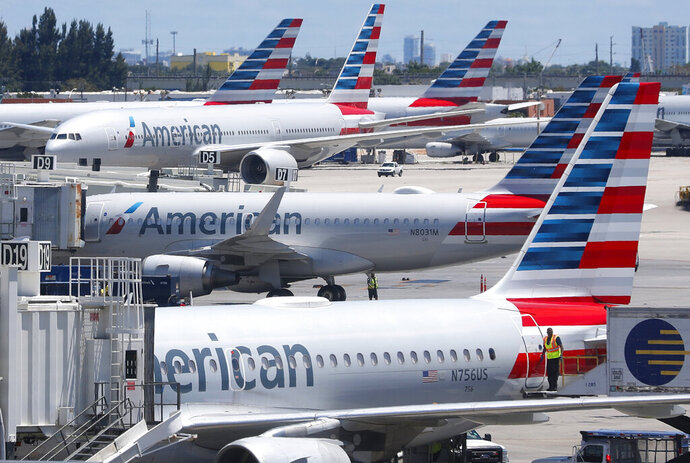 FILE - In this April 24, 2019, photo, American Airlines aircraft are shown parked at their gates at Miami International Airport in Miami. A bail hearing is scheduled for a mechanic charged with sabotaging an American Airlines jetliner as part of a labor dispute. Prosecutors are seeking pretrial detention for 60-year-old Abdul-Majeed Marouf Ahmed Alani at a hearing Wednesday, Sept. 18. (AP Photo/Wilfredo Lee, File)