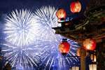 In this Tuesday, Dec. 3, 2019, photo, a lantern-covered float stands as fireworks light up the sky during the Chichibu Night Festival in Chichibu, Japan. Moving six towering floats up a hill and into the town center is the culminating moment of a Shinto festival that has evolved from a harvest thanksgiving into a once-a-year meeting between two local gods. (AP Photo/Toru Hanai)