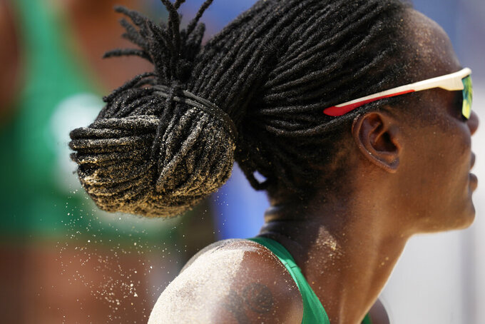 Gaudencia Makokha, of Kenya, competes during a women's beach volleyball match against the United States at the 2020 Summer Olympics, Thursday, July 29, 2021, in Tokyo, Japan. (AP Photo/Petros Giannakouris)