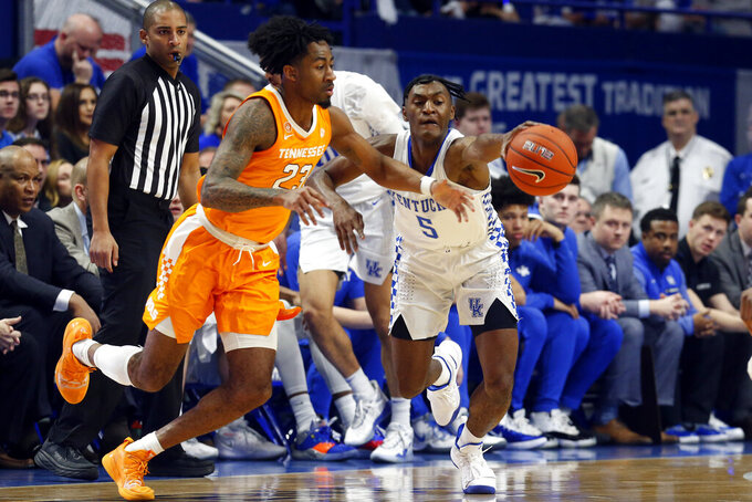 Kentucky's Immanuel Quickley (5) steals the ball from Tennessee's Jordan Bowden (23) during the first half of an NCAA college basketball game, Tuesday, March 3, 2020, in Lexington, Ky. (AP Photo/James Crisp)