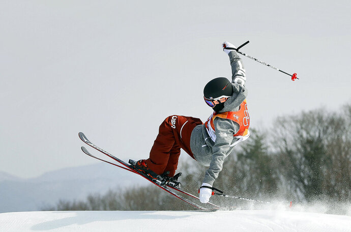FILE - In this Feb. 18, 2018, file photo, GusKenworthy, of the United States, jumps during the men's slopestyle final at the 2018 Winter Olympics in Pyeongchang, South Korea. These days, freestyle skier Gus Kenworthy is one tough act to follow. His talents have him starring in a variety of roles both on and off the slopes. He's an actor (recently appearing in