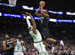 Minnesota Timberwolves forward Andrew Wiggins, right, shoots over Boston Celtics forward Guerschon Yabusele (30) during the first quarter of an NBA basketball game in Boston, Wednesday, Jan. 2, 2019. At left are Celtics guard Jaylen Brown (7) and Timberwolves center Karl-Anthony Towns (32). (AP Photo/Charles Krupa)