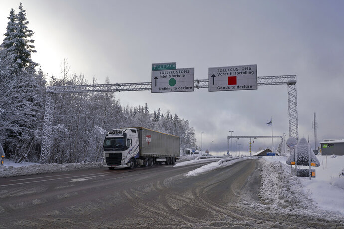 A truck passes the Norwegian border towards Sweden, on Friday, Feb. 8 2019.  Norway's hard border with the European Union is equipped with cameras, license-plate recognition systems and barriers directing traffic to Customs officers. Norway's membership in the European Economic Area (EEA) grants it access to the common market and most goods are exempt from paying duties but everything entering the country must be declared and cleared through customs. (AP Photo/David Keyton)