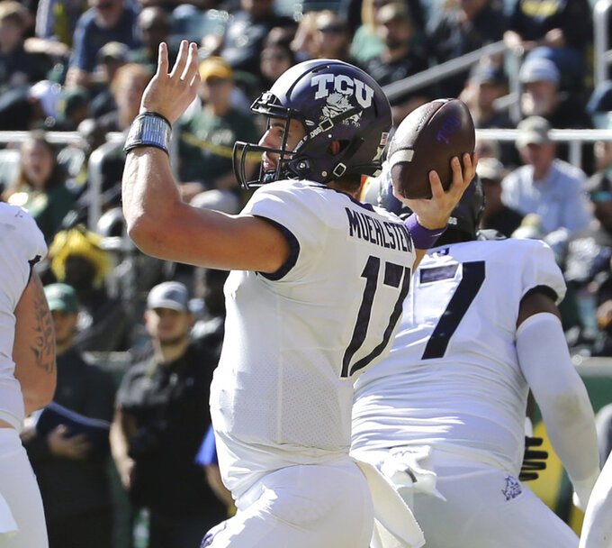 TCU quarterback Grayson Muehlstein (17) drops back to pass  in the first half of an NCAA college football game against Baylor, Saturday, Nov. 17, 2018, in Waco, Texas. (Jerry Larson/Waco Tribune Herald, via AP)