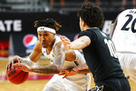 Cincinnati guard Jeremiah Davenport (24) drives to the basket as Vanderbilt forward Myles Stute (10) defends during the first half of an NCAA college basketball game Thursday, March 4, 2021, in Cincinnati. (Kareem Elgazzar/The Cincinnati Enquirer via AP)