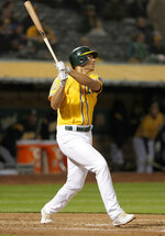 Oakland Athletics' Matt Olson (28) hits a home run against the Chicago White Sox during the fourth inning of a baseball game Monday, April 16, 2018, in Oakland, Calif. (AP Photo/Tony Avelar)