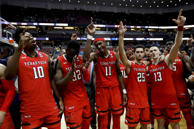 Texas Tech players celebrate after win against Michigan during an NCAA men's college basketball tournament West Region semifinal Thursday, March 28, 2019, in Anaheim, Calif. (AP Photo/Marcio Jose Sanchez)
