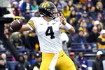 Iowa quarterback Nate Stanley (4) passes the ball against Northwestern during the first half of an NCAA college football game, Saturday, Oct. 26, 2019, in Evanston, Ill. (AP Photo/David Banks)