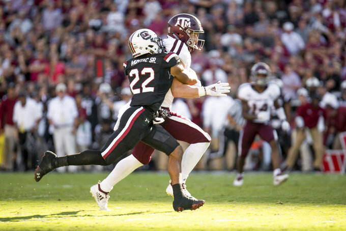 Texas A&M tight end Jace Sternberger (81) runs with the ball against South Carolina defensive back Steven Montac (22) during the first half of an NCAA college football game Saturday, Oct. 13, 2018, in Columbia, S.C. (AP Photo/Sean Rayford)