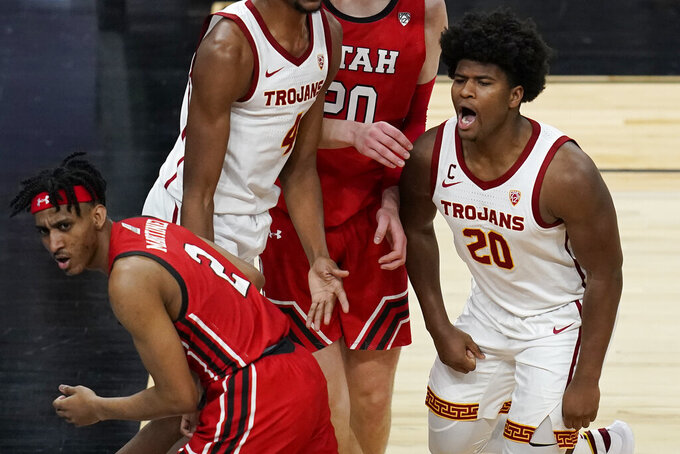 Southern California's Ethan Anderson (20) celebrates after a play against Utah during the second half of an NCAA college basketball game in the quarterfinal round of the Pac-12 men's tournament Thursday, March 11, 2021, in Las Vegas. (AP Photo/John Locher)