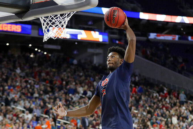 Auburn's Bryce Brown (2) goes up for a shot during a practice session for the semifinals of the Final Four NCAA college basketball tournament, Friday, April 5, 2019, in Minneapolis. (AP Photo/Charlie Neibergall)