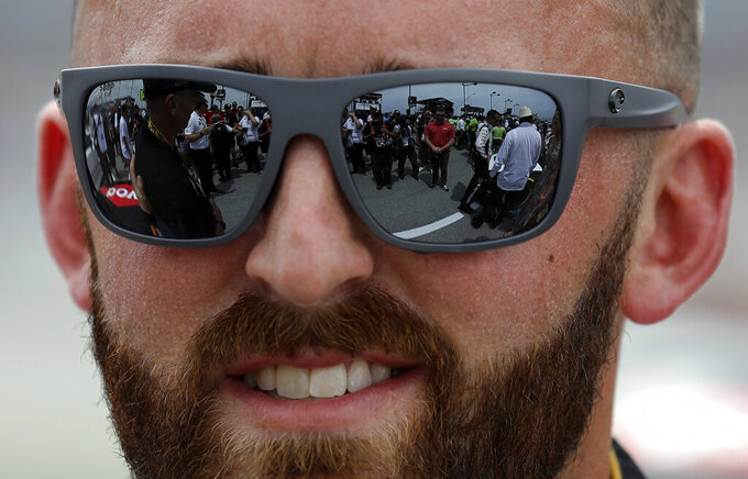 Austin Dillon looks at fans before a NASCAR Cup Series auto race at Chicagoland Speedway in Joliet, Ill., Sunday, June 30, 2019. (AP Photo/Nam Y. Huh)