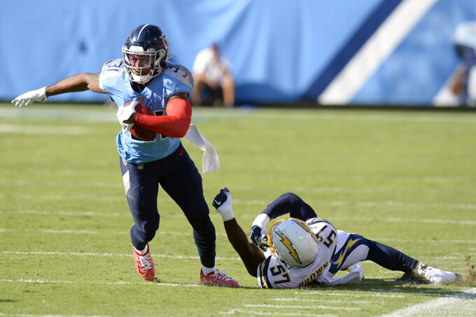 Tennessee Titans free safety Kevin Byard (31) runs the ball past Los Angeles Chargers outside linebacker Jatavis Brown (57) on a fake punt play in the first half of an NFL football game Sunday, Oct. 20, 2019, in Nashville, Tenn. (AP Photo/Mark Zaleski)