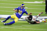 Los Angeles Rams quarterback Jared Goff (16) slides in front of Chicago Bears linebacker James Vaughters (93) during the second half of an NFL football game Monday, Oct. 26, 2020, in Inglewood, Calif. (AP Photo/Ashley Landis)