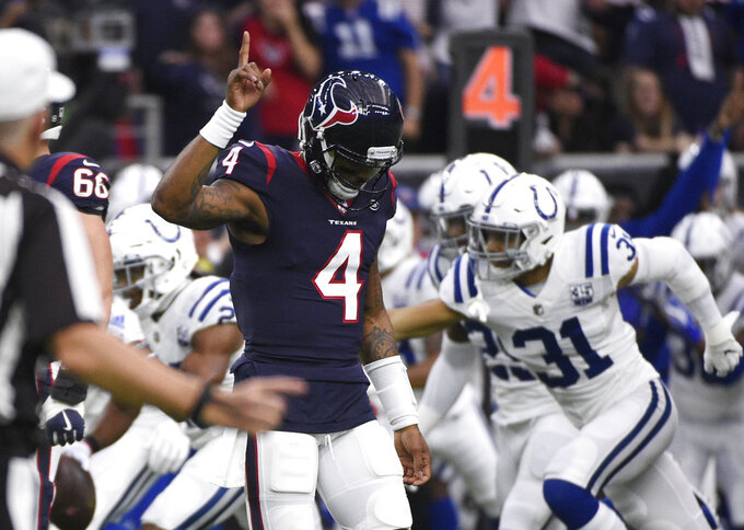 Houston Texans quarterback Deshaun Watson (4) reacts after he was intercepted by Indianapolis Colts cornerback Kenny Moore during the first half of an NFL wild card playoff football game, Saturday, Jan. 5, 2019, in Houston. (AP Photo/Eric Christian Smith)