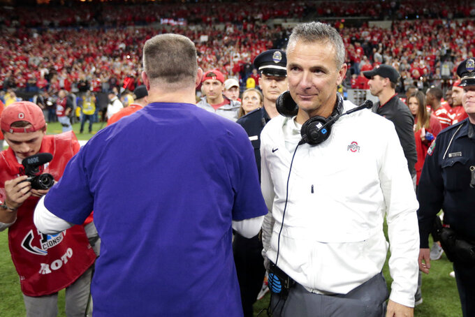 Ohio State head coach Urban Meyer, right, is congratulated by Northwestern head coach Pat Fitzgerald after Ohio State defeated Northwestern in the Big Ten championship NCAA college football game, Saturday, Dec. 1, 2018, in Indianapolis. Ohio State won 45-24. (AP Photo/AJ Mast)