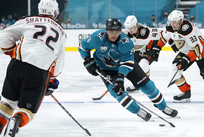 FILE - In this April 14, 2021, file photo, San Jose Sharks left wing Evander Kane (9) in action against the Anaheim Ducks during the third period of an NHL hockey game on Wednesday, in San Jose, Calif. The NHL suspending San Jose's Evander Kane 21 games for submitting a fake vaccination card and Washington State firing football coach Nick Rolovich for failing to comply with a vaccine mandate Monday provided two more reminders of the impact the coronavirus is still having on professional and college sports. (AP Photo/ Tony Avelar, File)