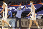 North Carolina coach Roy Williams waves goodbye to the Virginia coaching staff after an NCAA college basketball game Saturday, Feb. 13, 2021, in Charlottesville, Va. (Andrew Shurtleff/The Daily Progress via AP, Pool)