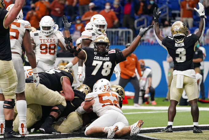 Colorado players celebrate a touchdown by running back Jarek Broussard against Texas during the first half of the Alamo Bowl NCAA college football game Tuesday, Dec. 29, 2020, in San Antonio. (AP Photo/Eric Gay)