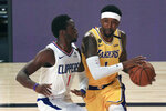 Los Angeles Lakers Kentavious Caldwell-Pope, right, collides with Los Angeles Clippers Reggie Jackson, left, during an NBA basketball game Thursday, July 30, 2020, in Lake Buena Vista, Fla. (Mike Ehrmann/Pool Photo via AP)