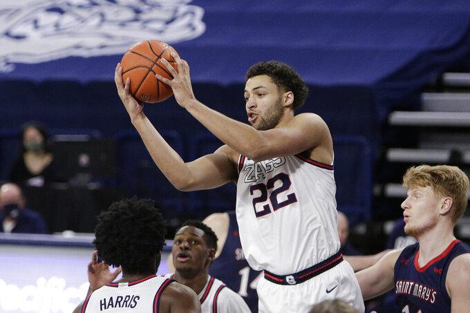 Gonzaga forward Anton Watson (22) grabs a rebound during the second half of an NCAA college basketball game against Saint Mary's in Spokane, Wash., Thursday, Feb. 18, 2021. Gonzaga won 87-65, (AP Photo/Young Kwak)