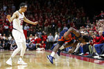 Illinois guard Da'Monte Williams (20) falls out of bounds after being fouled by Rutgers guard Caleb McConnell (22) during the first half of an NCAA college basketball game Saturday, Feb. 15, 2020, in Piscataway, N.J. (AP Photo/Adam Hunger)