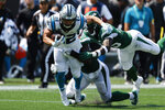 Carolina Panthers running back Christian McCaffrey runs against the New York Jets during the first half of an NFL football game Sunday, Sept. 12, 2021, in Charlotte, N.C. (AP Photo/Nell Redmond)