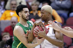 Oregon's Ehab Amin, left, and Virginia's Mamadi Diakite, right, battle for a rebound during the second half of a men's NCAA Tournament college basketball South Regional semifinal game, Thursday, March 28, 2019, in Louisville, Ky. (AP Photo/Michael Conroy)