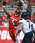 Houston quarterback D'Eriq King, left, throws a pass as Arizona linebacker Colin Schooler (7) defends during the first half of an NCAA college football game, Saturday, Sept. 8, 2018, in Houston. (AP Photo/Eric Christian Smith)