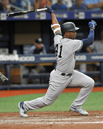 New York Yankees' Miguel Andujar watches his single off Tampa Bay Rays reliever Emilo Pagan during the sixth inning of a baseball game Friday, May 10, 2019, in St. Petersburg, Fla. (AP Photo/Steve Nesius)