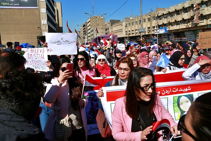 Women take part in a protest in Tahrir Square, Baghdad, Iraq, Thursday, Feb. 13, 2020. Hundreds of Iraqi women took to the streets of central Baghdad and southern Iraq on Thursday in defiance of a radical cleric's calls for gender segregation in anti-government protest sites. Iraqis began protesting on Oct. 1 to decry rampant government corruption, poor services and unemployment. The protests have been unique because they have drawn both men and women who have camped out alongside each other in protest squares, a rare occurrence in Iraq.  (AP Photo/Khalid Mohammed)