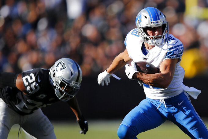 Detroit Lions wide receiver Danny Amendola (80) runs against Oakland Raiders free safety Lamarcus Joyner (29) during the second half of an NFL football game in Oakland, Calif., Sunday, Nov. 3, 2019. (AP Photo/John Hefti)