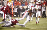 Mississippi quarterback Jordan Ta'amu slips past Arkansas defender Kamren Curl to score a touchdown in the first half of an NCAA college football game Saturday, Oct. 13, 2018, in Little Rock, Ark. (AP Photo/Michael Woods)