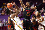 Minnesota's Jamal Mashburn Jr., left, attempts a shot as Maryland's Aquan Smart defends in the first half of an NCAA college basketball game, Saturday, Jan. 23, 2021, in Minneapolis. (AP Photo/Jim Mone)