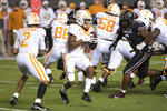 Tennessee wide receiver Velus Jones Jr. (1) takes a handoff from quarterback Jarrett Guarantano (2) during the first half of the team's NCAA college football game against South Carolina on Saturday, Sept. 26, 2020, in Columbia, S.C. (AP Photo/Sean Rayford)