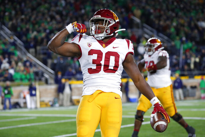Southern California running back Markese Stepp flexes his bicep after scoring on a 2-yard touchdown run in the second half of an NCAA college football game against Notre Dame in South Bend, Ind., Saturday, Oct. 12, 2019. (AP Photo/Paul Sancya)