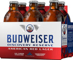 This image provided by Budweiser in June 2019 shows packaging for their Discovery Reserve beer. It revives a recipe from the 1960s and features 11 symbolic stars around their logo, in honor of the 50th anniversary of the Apollo 11 moon landing. (Budweiser via AP)