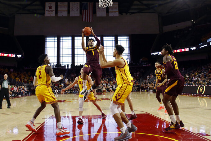 Arizona State guard Remy Martin (1) drives to the basket during the first half of an NCAA college basketball game against Southern California Saturday, Feb. 29, 2020, in Los Angeles. (AP Photo/Marcio Jose Sanchez)
