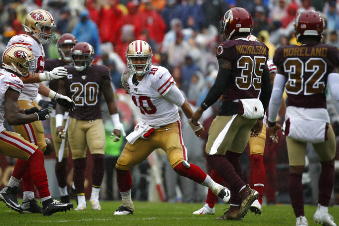 San Francisco 49ers quarterback Jimmy Garoppolo (10) reacts after rushing the ball in the first half of an NFL football game against the Washington Redskins, Sunday, Oct. 20, 2019, in Landover, Md. (AP Photo/Alex Brandon)