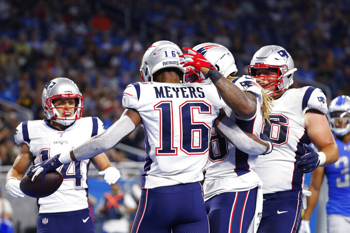 New England Patriots receiver Jakobi Meyers (16) is congratulated by teammates after his 5-yard touchdown reception during the first half of a preseason NFL football game against the Detroit Lions, Thursday, Aug. 8, 2019, in Detroit. (AP Photo/Rick Osentoski)